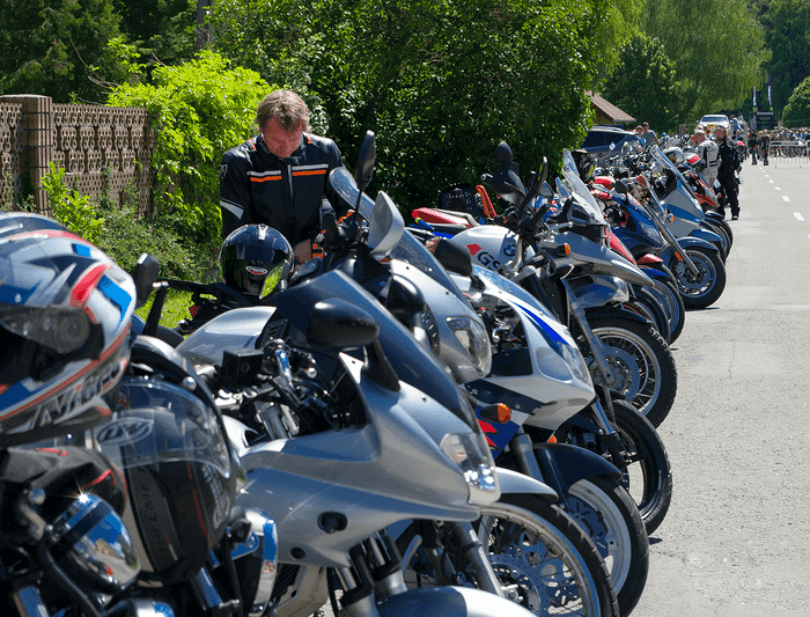 A group of motorbikes in a line preparing for an enhanced rider course