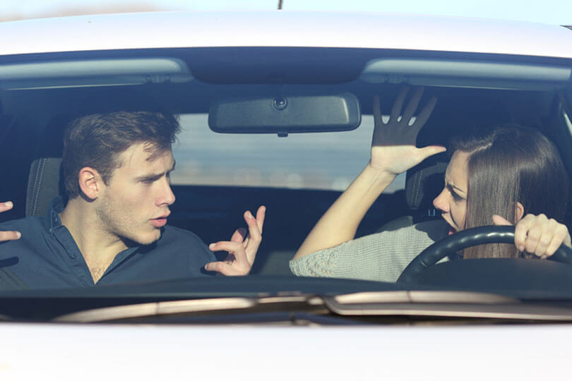 Couple arguing in car