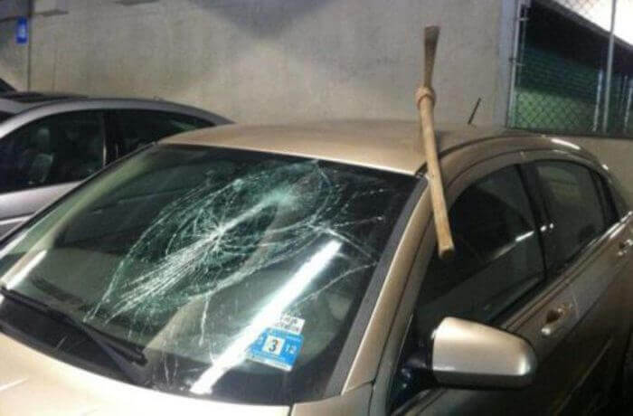 Pickaxe stuck in a car's roof