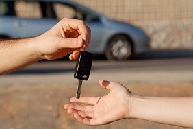 handing over car keys