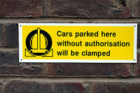Parking clamp warning sign