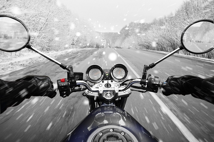 Person driving motorbike in winter